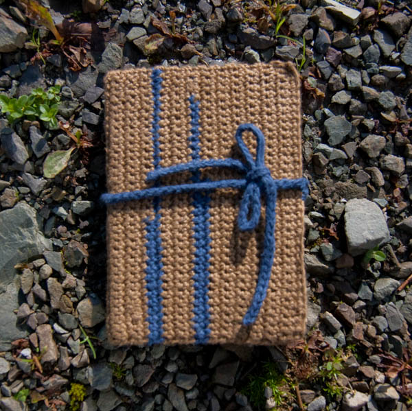 Crochet cover notebook with found paper